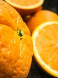 Fresh ripe oranges. Full and sliced Stock Photo