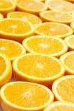 Fresh ripe oranges halved as background Stock Images