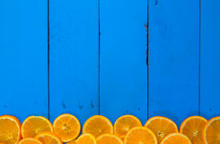 Fresh ripe oranges on wooden table. Top view with copy space Stock Photos