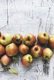 Fresh ripe organic apples on wooden background. Autumn Harvest. Healthy snack Royalty Free Stock Photo