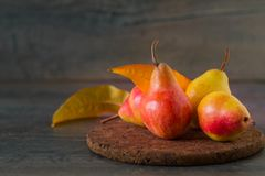Fresh ripe organic autumn pears. On rustic wooden table Royalty Free Stock Image