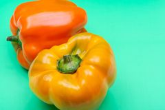 Fresh Ripe Organic Bell Peppers, a cultivar group of the species Capsicum annuum, isolated on green. Background stock photo