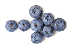 Fresh ripe organic blueberries isolated on white background. Bio bilberry in arrow pointer shape. Healthy diet.  Royalty Free Stock Image