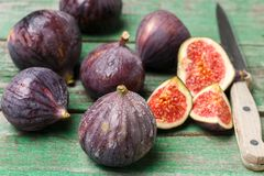 Fresh ripe organic figs. With drops of water on a wooden table. Selective focus Royalty Free Stock Photos