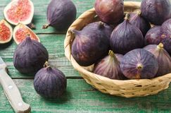 Fresh ripe organic figs. With drops of water on a wooden table. Selective focus Stock Photos