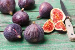 Fresh ripe organic figs. With drops of water on a wooden table. Selective focus Stock Photo