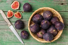 Fresh ripe organic figs. With drops of water on a wooden table. Selective focus Royalty Free Stock Photo