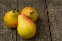 Fresh ripe organic pears on a rustic wooden table.  Stock Images