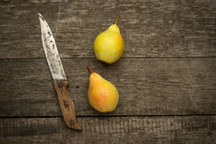 Fresh ripe organic pears on a rustic wooden table Royalty Free Stock Image