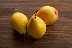 Fresh ripe organic pears on a rustic wooden table.  Royalty Free Stock Image
