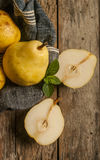 Fresh ripe organic pears on a rustic wooden table. Close up Stock Images