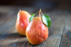 Fresh ripe organic pears on a rustic wooden table Stock Images