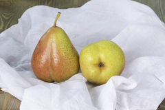 Fresh ripe organic pears. On white cotton Royalty Free Stock Images
