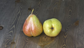 Fresh ripe organic pears. On wooden table with black background Stock Photo