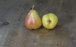 Fresh ripe organic pears. On wooden table with black background Royalty Free Stock Images