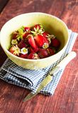 Fresh ripe organic strawberry in a white colander on a wooden table, selective focus. Harvest time. Raw berry. Organic and healthy. Food option. Healthy dessert Royalty Free Stock Photography
