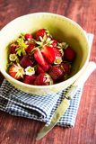Fresh ripe organic strawberry in a white colander on a wooden table, selective focus. Harvest time. Raw berry. Organic and healthy. Food option. Healthy dessert Stock Images