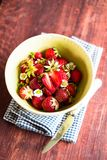 Fresh ripe organic strawberry in a white colander on a wooden table, selective focus. Harvest time. Raw berry. Organic and healthy. Food option. Healthy dessert Stock Photo