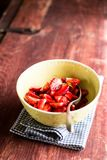 Fresh ripe organic strawberry in a white colander on a wooden table, selective focus. Harvest time. Raw berry. Organic and healthy. Food option. Healthy dessert Royalty Free Stock Image