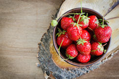 Fresh ripe organic strawberry on wooden background. Rustic style. Selective focus Royalty Free Stock Image