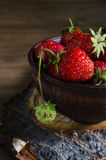 Fresh ripe organic strawberry on wooden background. Rustic style. Selective focus Stock Images