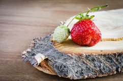 Fresh ripe organic strawberry on wooden background. Rustic style. Selective focus Stock Photography