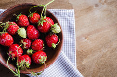 Fresh ripe organic strawberry on wooden background. Rustic style. Selective focus Stock Photo