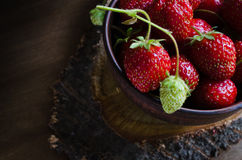 Fresh ripe organic strawberry on wooden background. Rustic style. Selective focus Royalty Free Stock Images