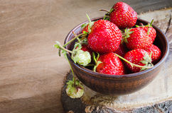 Fresh ripe organic strawberry on wooden background. Rustic style. Selective focus Stock Photos