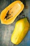Fresh ripe papaya. On wooden background Royalty Free Stock Photos