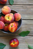 Fresh and ripe peaches in bowl Royalty Free Stock Images
