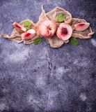 Fresh ripe peaches on concrete background Royalty Free Stock Photography