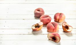 Fresh ripe peaches. On a white wooden table Stock Photo