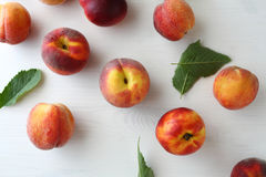 Fresh ripe peaches and green leaves. Above Royalty Free Stock Photo