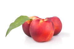 Fresh ripe peaches with leaf Royalty Free Stock Photography