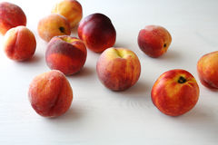 Fresh ripe peaches. On white table Stock Photos