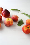Fresh ripe peaches. On white table Royalty Free Stock Image