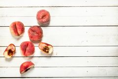 Fresh ripe peaches. On a white wooden table Royalty Free Stock Images