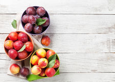 Fresh ripe peaches. On wooden table. Top view with space for your text Stock Photography