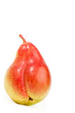 Fresh ripe pear on white. Fresh, yellow-red ripe pear isolated on white Stock Images