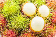Fresh and ripe peel rambutans, delicious fruits for asian Royalty Free Stock Image