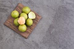 Fresh ripe peeled quenepa fruit - Melicoccus bijugatus. Mamoncillo delicious tropical fruit - Melicoccus bijugatus Royalty Free Stock Image