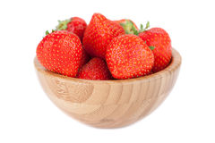 Fresh ripe perfect strawberry in wooden plate. Stock Images