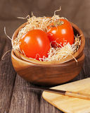 Fresh ripe persimmon in bowl on wooden table. Stock Photos