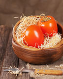 Fresh ripe persimmon in bowl on wooden table. Royalty Free Stock Photo
