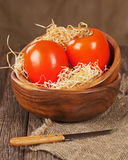 Fresh ripe persimmon in bowl on wooden table. Stock Photo