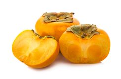 Fresh ripe persimmons an isolated on white background Royalty Free Stock Image