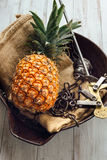 Fresh ripe pineapple. On bowl on the table Royalty Free Stock Images