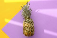 Fresh ripe pineapple on color background. Top view Royalty Free Stock Photography