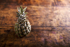 Fresh ripe pineapple laid on wooden table, copy space Stock Photos